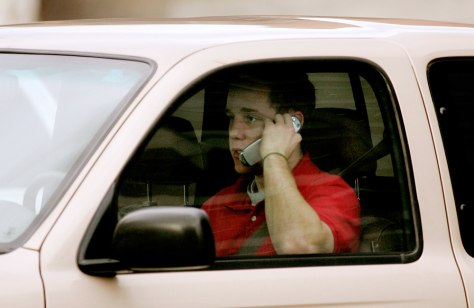 man talks on phone while driving in Salt Lake City