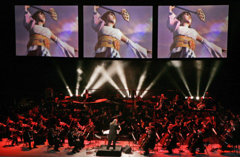 "Orchestra plays as ""Final Fantasy"" images broadcast overhead"