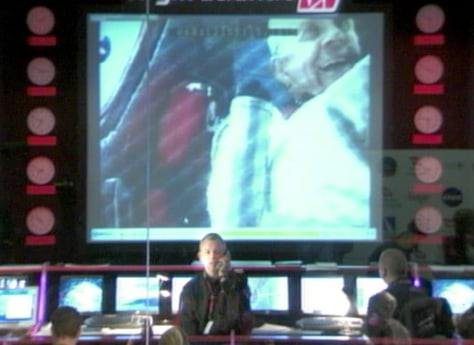 Image: Fossett on screen at mission control
