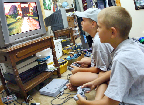 Two young children play video games