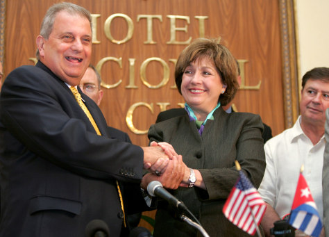 Louisiana state Governor Kathleen Blanco shakes hands with Alvarez from Cuban food import agency Alimport