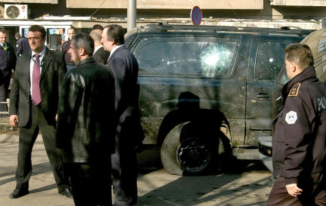 Image: Damaged vehicle in Kosovo president's convoy.