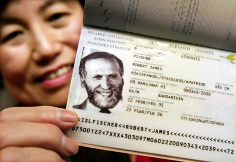 Watai, fiancee of chess grand master Bobby Fischer, shows his new Iceland passport in Tokyo