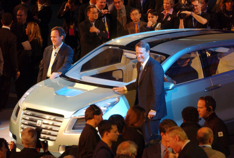 General Motors executives Wagoner and Burns pose with new hydrogen fuel cell powered Sequel concept vehicle