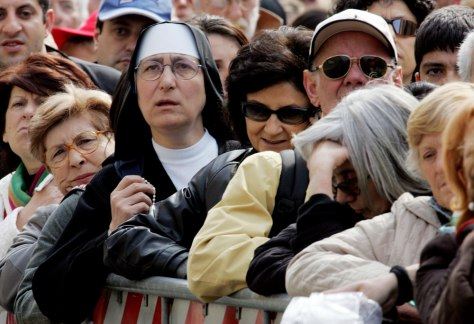 Thousands Line The Streets To View The Body Of John Paul II