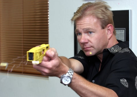 TASER EXECUTIVE SHOWS STUN GUN
