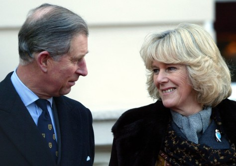 Britain's Prince Charles stands with his fiancee Camilla Parker Bowles during an engagement at Clarence House in London