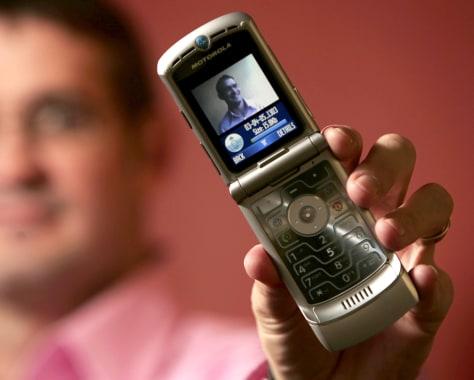cell phone designer holds Razr phone