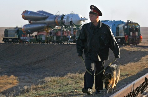 Guard patrols as Soyuz taken to launch pad