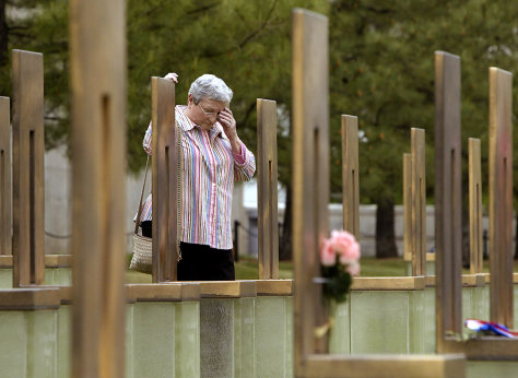 Woman reacts at daughters memorial chair at Oklahoma City National Memorial on eve of bombing anniversary