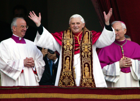 Pope Benedict XVI waves from a balcony of St. Peter's Basilica