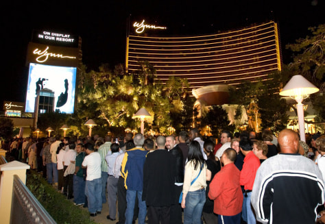 Thousands of people line up on the sidewalk on the Las Vegas Strip while waiting to get into the newly-opened Wynn Las Vegas just after the $2.7 billion resort opened to the public at midnight