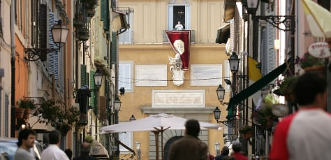 Pope Benedict XVI appears from the centr