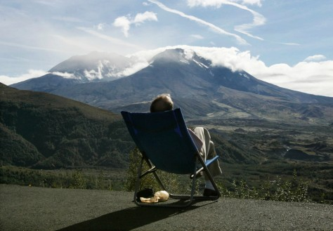 Visitor relaxes in the afternoon sun while watching Mount St. Helens
