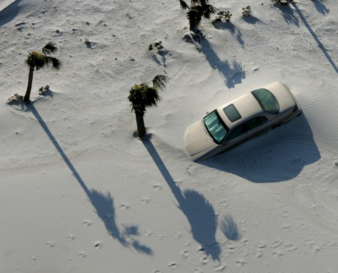 IMAGE: CAR BURIED IN SAND FROM 2004 HURRICANE