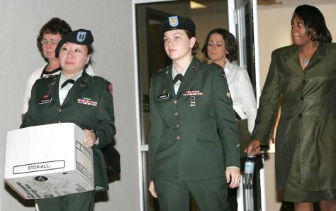U.S. Army Spc. Sabrina Harman andher attorneys Capt. Patsy Takemura and Sgt. Davida McGriff