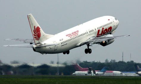 A plane operated by Indonesia's budget airline Lion Air takes off from Jakarta's main airport. The carrier plans to buy 60 Boeing 737 aircraft as part of a bold plan to expand across Asia.