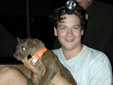 IMAGE: RESEARCHER WITH FOSSA