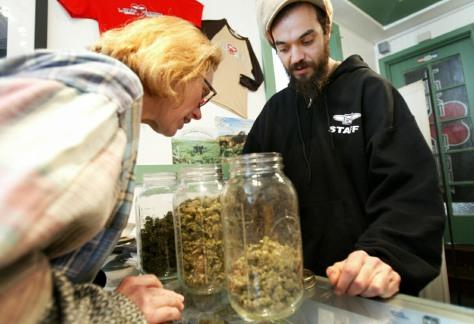 Image: Medical marijuana patient visits a medicinal cannabis shop.