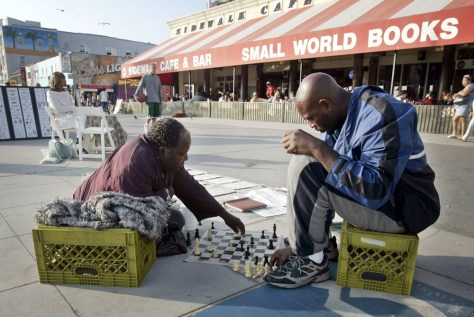 Image: People play chess in Venice Beach.