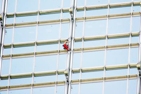 Image: Alain Robert climbs Hong Kong skyscraper.