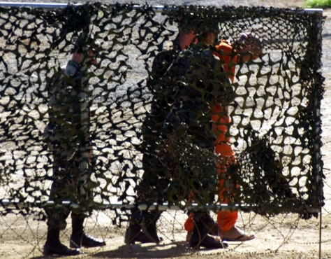 File photo of US Marines escorting a new detainee at Guantanamo Naval Base in Cuba