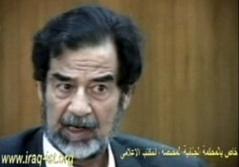 IMAGE: SADDAM RESPONDS TO COURT QUESTION