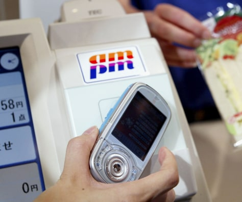 cell phone being scanned at convenience store