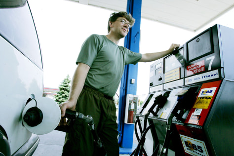 IMAGE: MAN FILLING UP WITH GAS