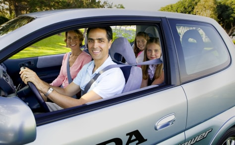 IMAGE: FAMILY WITH LEASED FUEL CELL VEHICLE