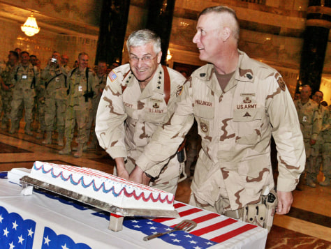Commander of Multinational Forces in Iraq cuts cake at 4th of July ceremony in Baghdad