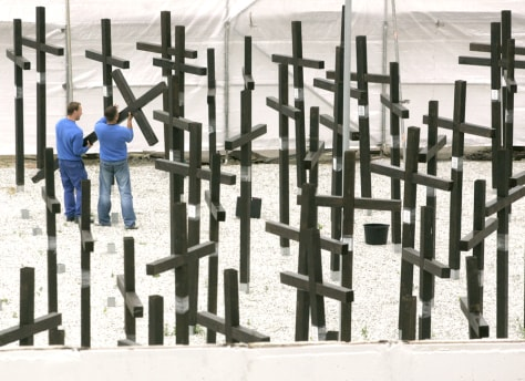 Image: Workers tear down museum's crosses.