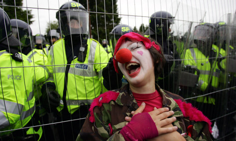 An anti-G8 protester dressed as a clown