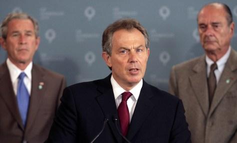 Image: British Prime Minister Tony Blair, center.