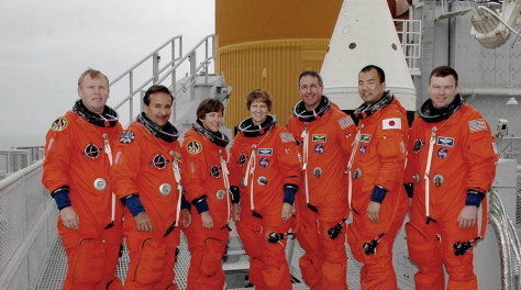 Discovery's crew poses on launch pad.