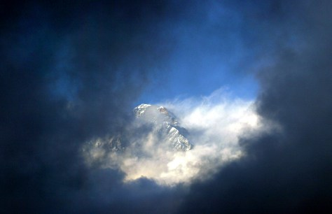 IMAGE: Mount Everest seen through the clouds