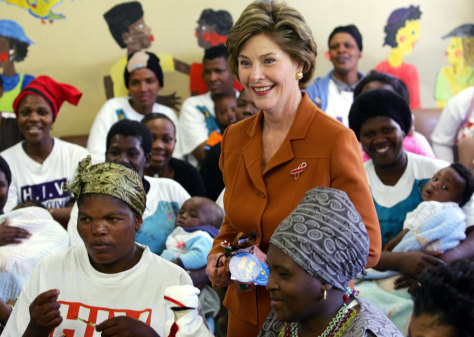 US first lady Laura Bush poses with participants during visit to Aids project in Cape Town's Khayelitsha township