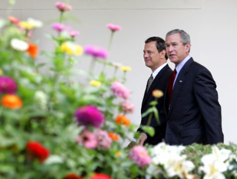 US President Bush and Supreme Court nominee Roberts walk toward Oval Offie, White House