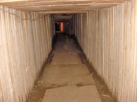 Handout photo shows tunnel dug by drug traffickers under US-Canada border in Aldergrove, British Columbia