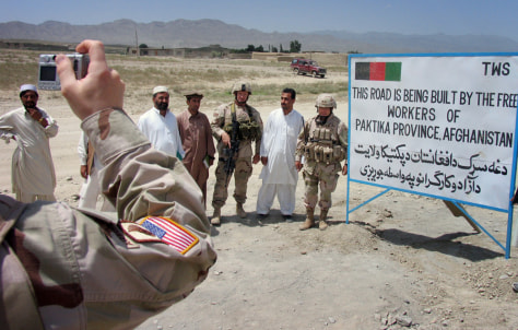 Image: U.S. soldiers and Afghan workers