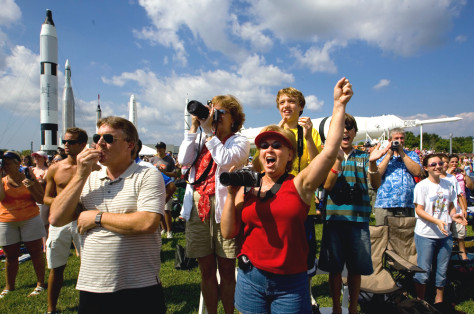 Crowd cheers space shuttle launch