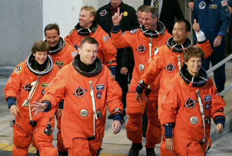 Shuttle crew walks out