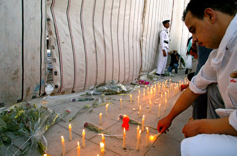 Egyptians light candles and lay flowers