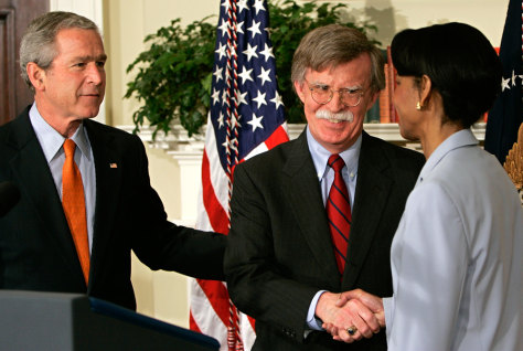 John Bolton (C) is congratulated by Rice