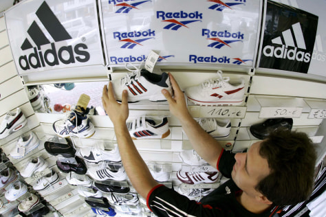 Hosemann arranges sports shoes in his store in the northern German town of Hamburg