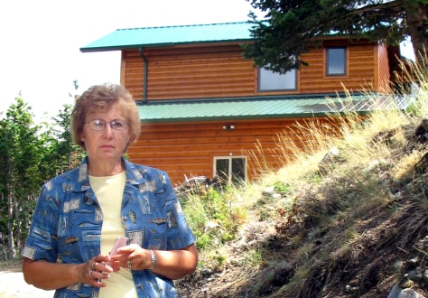 Image: Sandi Crawford near her wooded home in Montana
