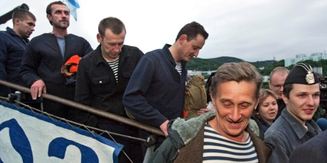 Image: Rescued submariners return to land.