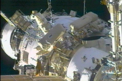 Krikalev and Phillips work outside space station