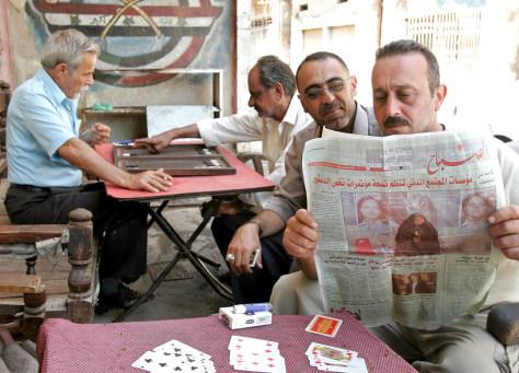 IMAGE: Newspapers in Baghdad