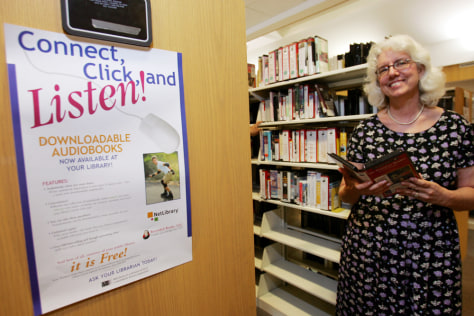 Guilderland Public Library director holds audiobook